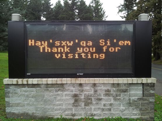 Royal Roads University digital readerboard thanking departing visitors in Lkwungen.  Hych'ka Si'em!
